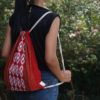 Empower Mishing Drawstring Bag (Multicolour on Red)